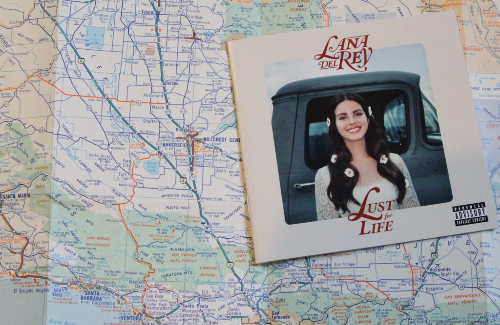 A Lana Del Rey album booklet on a map